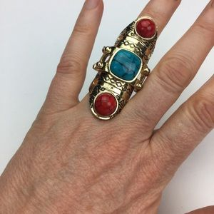 Gold knuckle ring with turquoise and orange stones